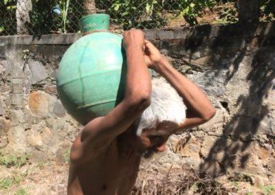 El Salvadorian man carrying water