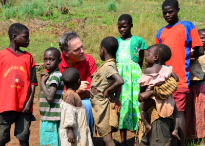 Steve visiting with Ugandan World Vision helped children.