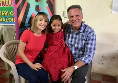 Joni and Steve with their sponsored child in El Salvador